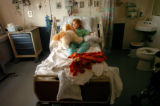 [Denver, CO - Shot on: 8/11/04] Sabrina McKinney, 8, of Erie, Colo, lies next to a teddy bear...