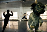 MJM290  Shunsuke Amma (cq), left, dances along with Casey Dalton (cq), center, and Tomasz Kumor...