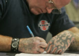Joshua Daleigh (CQ), 34, of Denver fills out application forms as he joined a little under 100...