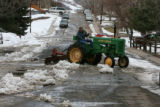 The warmer weather permitted Ron Poland (cq) to use his 1948 John Deere tractor to break up the...