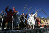 "Riders on the float ""Grannies Gone Wild"" shake their walkers to the music before the..."