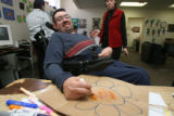 Don Speegle, (cq, and verified from supervisor) works dilligently from his wheelchair coloring...