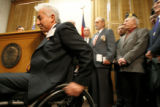 Vietnam veteran, Artie Guerreo, cq, moves out of the way of others after just speaking along with...