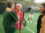 Joanne Kouris (cq), left, of Denver, greets Marion Downs (cq), before a tennis game at the Meadow...