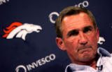 Denver Broncos coach Mike Shanahan grimaces as he talks about his team's offense's low overall,...