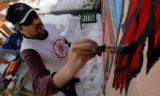 "[JPM202] Mark G. Martinez Luna paints a mural called ""A Pleasant Village"" on a shed..."