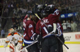 The Colorado Avalanche's Joe Sakic (#19, C) celebrates with teammates after scoring an overtime...