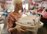 BG0168 Volunteer Mary Ann Long, CQ, 70, buzzes around with boxes of mail to replenish volunteers...