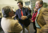 New Mexico Governor Bill Richardson, middle, shakes hands with local Denver labor leader Lawrence...