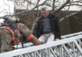 Fourth floor resident Bob Warner (cq) is rescued as Denver firefighters battled  a high rise...