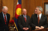 Gov. Bill Ritter, right, introduces three new co-chairs of the Colorado Transportation Finance and...