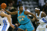 The Denver Nuggets' Carmelo Anthony (#15) guards the New Orleans Hornets Desmond Mason (#24) as...