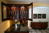 MJM410 Silver goblets are on display in the dining room of Ken and Nancy Shwayder's Denver ranch...