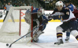 [JPM0265] Colorado Avalanche goalie Jose Theodore (60) reaches for the puck against Atlanta...