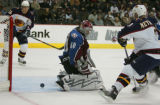 [JPM0339] Colorado Avalanche goalie Jose Theodore (60) has the puck squirt past him from Atlanta...