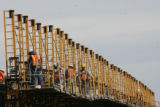 (DLM7637) -  Workers work on a Target that is under construction on a site where there used to be...