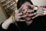 Mieke Thorson holds up some of the jewelry in her house in Park Hill in Denver on February 23,...