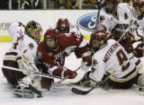 MAEA106 - Harvard's Paul Dufault (12) attempts a shot against Boston College goaltender Cory...