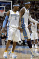 New Denver Nugget teammates  Allen Iverson,left, and Carmelo Anthony,right, share a laugh during...