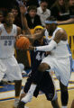 Denver Nugget Carmelo Anthony passes the ball around Memphis Grizzlies Lawrence Roberts (44) to...