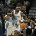 [JPM003] Denver Nuggets Allen Iverson, left, collides with teammate Nuggets forward Carmelo...
