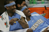 [JPM632] Denver Nuggets guard Allen Iverson, left, and forward Carmelo Anthony laugh at play on...