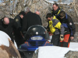 Jefferson County Sheriff Deputies and members of the Alpine Search and Rescue group with the body...