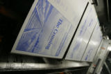 BG0111  A metal plate of the Rocky Mountain News front page hangs on a new printing press during...
