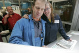 BG0492  Workers smile as the first run of the newly re-designed Rocky Mountain News is finally...
