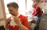 BG0149 Delaine Phillips, CQ, 76, left, licks a personal envelope that she wanted to personaly...