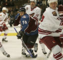 [JPM006]  Colorado Avalanche Tyler Arnason works through traffic of Phoenix Coyotes Georges...