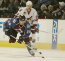 [JPM522]  Colorado Avalanche Antti Laaksonen passes the puck ahead of Phoenix Coyotes Yanic...
