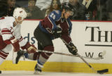 [JPM494]  Colorado Avalanche Paul Stastny skates against Phoenix Coyotes Travis Roche in the third...