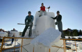 Team Canada snow sculptors (left to right, all cq) Doug Bisson, Walt Farr and Ron Pearce, all of...