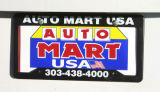 Top salesman, Hector Rojas, (cq), in the front lot of Auto Mart Usa, 5301 W. Colfax Ave.,...