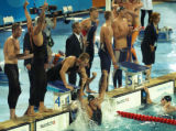 (Athens, Greece  on Sunday, Aug. 15, 2004) - South African relay team member Ryk Neethling raise...