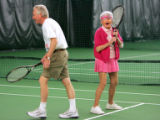 Marion Downs (cq), 93, jokes with tennis partner Stephen Crout (Cq), of Denver, during a doubles...