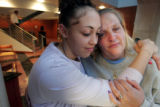 Tiffany Fisher (cq) , 18 a 4.0 GPA student at Hinkley H.S. in Aurora hugs her mother, Mary...