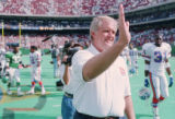 SEPT. 5, 1993 FILE PHOTO - Broncos coach Wade Phillips waves at the end of the game after his...