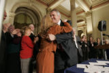 BG0216 Governor Bill Ritter hugs House Majority leader Alice Madden(D-Boulder) after signing his...