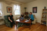 Dawn Claton, Sarah Dukes, Geri Bigum, (cq all), sit together in the finished, staged, living room...
