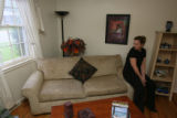 Dawn Claton, (cq), home owner, sits in the finished staged living room...She was very surprised at...