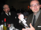 Magicians Jamy Ian Swiss, left, and and Eric Mead perform their magic for fundraising tips at the...