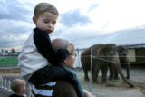 MJM066  Tristan Peninger, 3, gets a birds eye view of elephants from the shoulders of his father,...