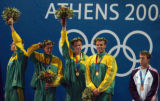 (Athens, Greece  on Sunday, Aug. 15, 2004) - American swimmer Michael Phelps, right, stands next...