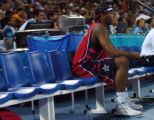 (ATHENS, GREECE, AUGUST 15, 2004) Team USA's Carmelo Anthony, sits on the bench watching the game...
