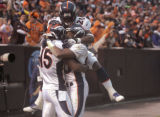 Denver Broncos wide receiver Brandon Marshall, left, celebrates his touch down in the third...