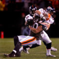 John Lynch wrestles down Kellen Winslow in the fourth quarter of the Denver Broncos against the...