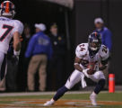 Denver Broncos cornerback Champ Baily makes an interception in the Cleveland Browns endzone in the...
