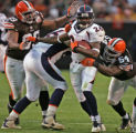 Denver Broncos running back Tatum Bell runs for a 13 yard gain in the fourth quarter against the...